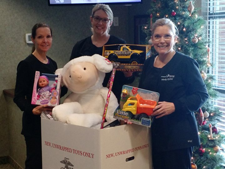 Team members collecting toys for drive
