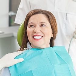 Smiling senior woman in dental chair