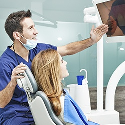 Dentist showing patient x-rays