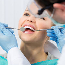 Woman having smile examined
